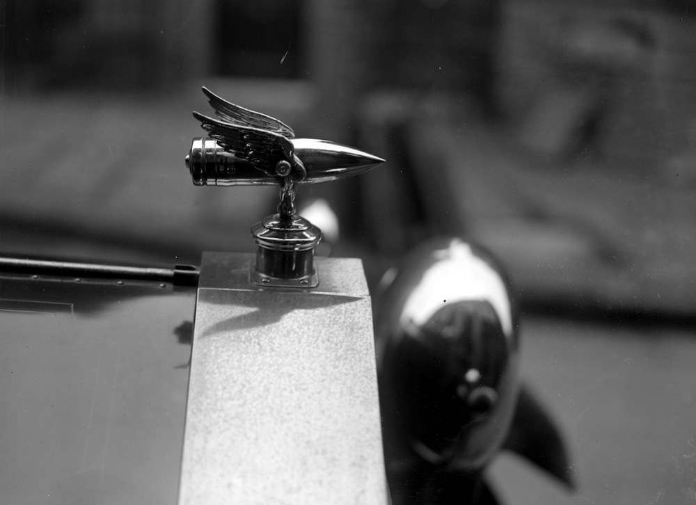 1929:  A winged bullet mascot on the bonnet of politician David Lloyd George's car.  (Photo by Fox Photos/Getty Images)