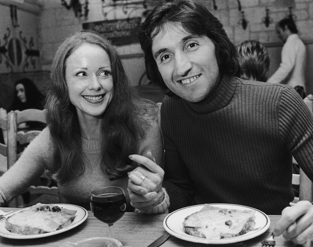 Photographer Ray Bellisario and his fiance, Annie Collins, enjoy a meal in a restaurant, 3rd October 1972. (Photo by Tim Graham/Evening Standard/Hulton Archive/Getty Images)