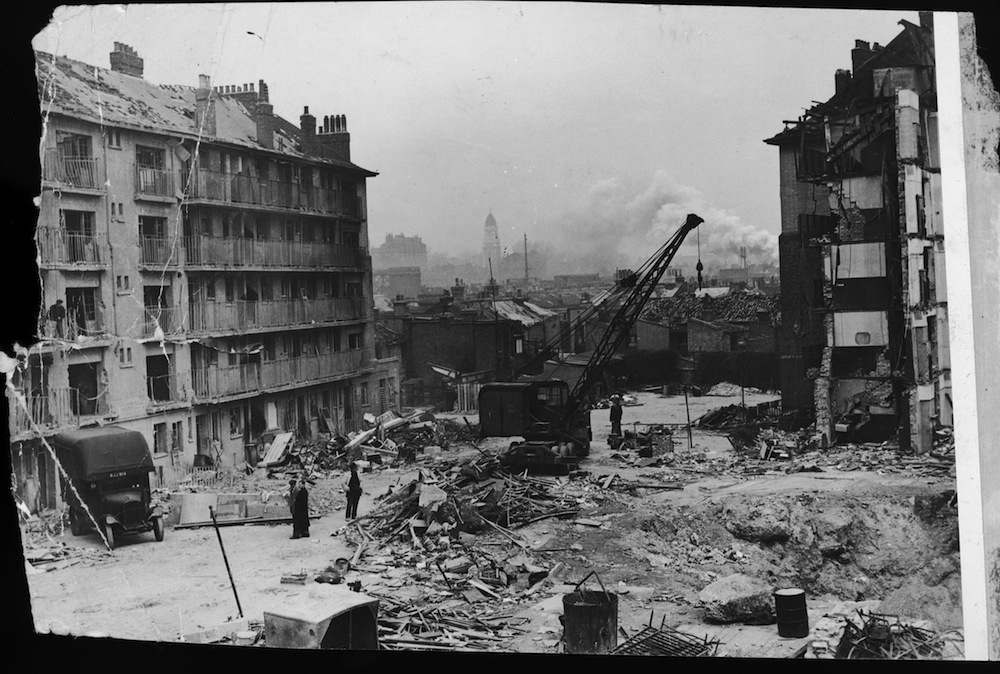 The wreckage of council flats known as Hughes Mansions in Vallance Road Stepney after a V2 rocket attack on the 27th March 1945, in which 134 people died. The weapon used in the attack was the last bomb of the war to fall on London.  (Photo by Topical Press Agency/Hulton Archive/Getty Images)