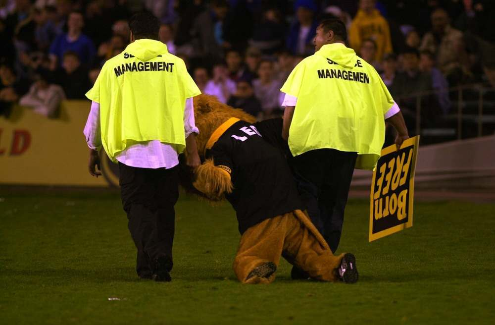 AUCKLAND, NEW ZEALAND - OCTOBER 13:  Wellington mascot Leo the Lion is removed from the ground by security staff, during his teams 4823 win over Auckland in the Air New Zealand 1st division NPC semi final at Eden Park, Auckland, Friday.  (Photo by Ross Land/Getty Images)