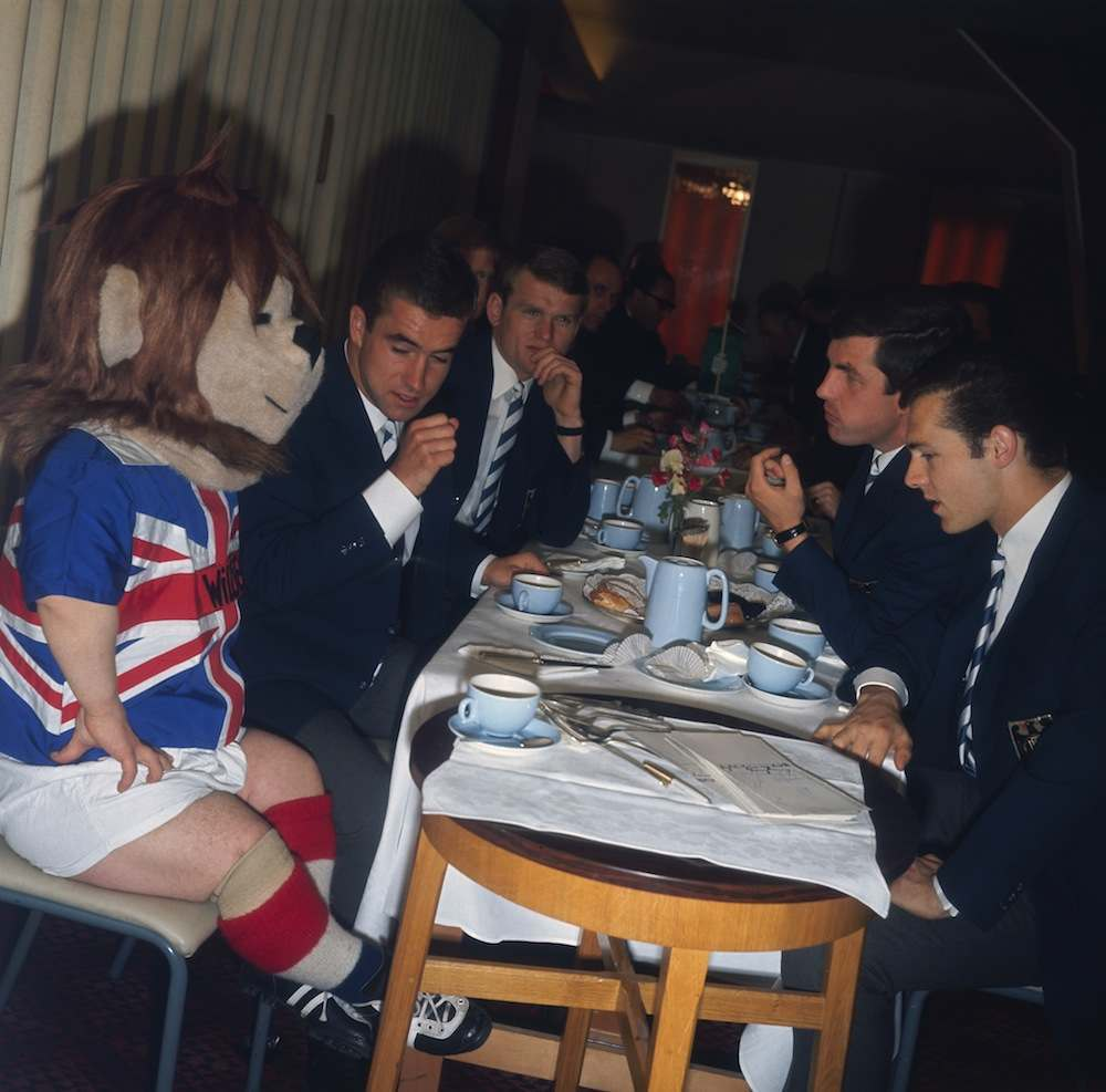 World Cup mascot World Cup Willie having afternoon tea with the West Germany squad at Ashbourne, Derbyshire, during the 1966 World Cup in England, 12th July 1966. (Photo by Hulton Archive/Getty Images)