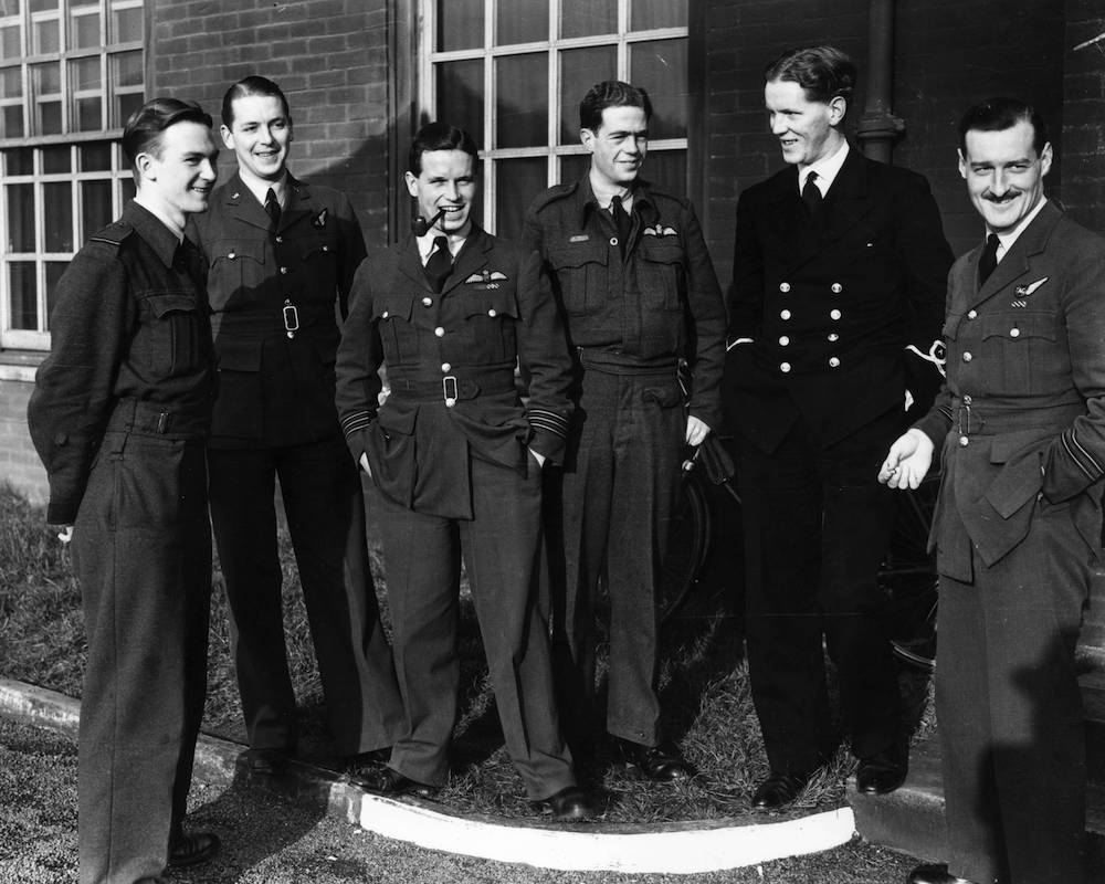 January 1943: Wing Commander Guy Gibson (smoking pipe), and members of his Lancaster bomber air crew after a bombing raid on Berlin. Gibson later led the 'Dambusters' raid. (Photo by Central Press/Getty Images)