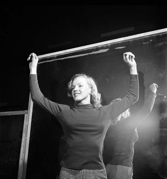 American actress Marilyn Monroe (born Norma Jeane Mortenson, 1926 - 1962) stands with her back to a mirror during an acting lesson, Hollywood, California, November 1948. (