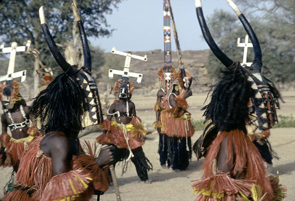 Sirige, Kanaga and buffalo masqueraders during the Dama ceremony, Sanga, Mali