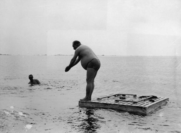 1893:  A large bather about to dive from a raft into the sea at Jersey. He is one of a party of three from Birmingham.  (Photo by Paul Martin/George Eastman House/Getty Images)