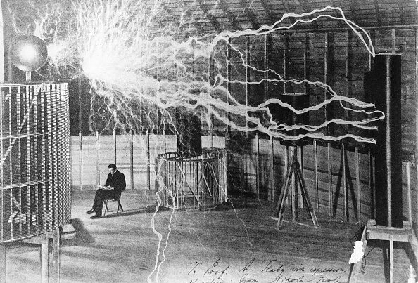 (GERMANY OUT) NIKOLA TESLA (1856-1943). American electrician, physicist and inventor. Tesla studying electricity in the laboratory, 1900. (Photo by ullstein bild/ullstein bild via Getty Images)