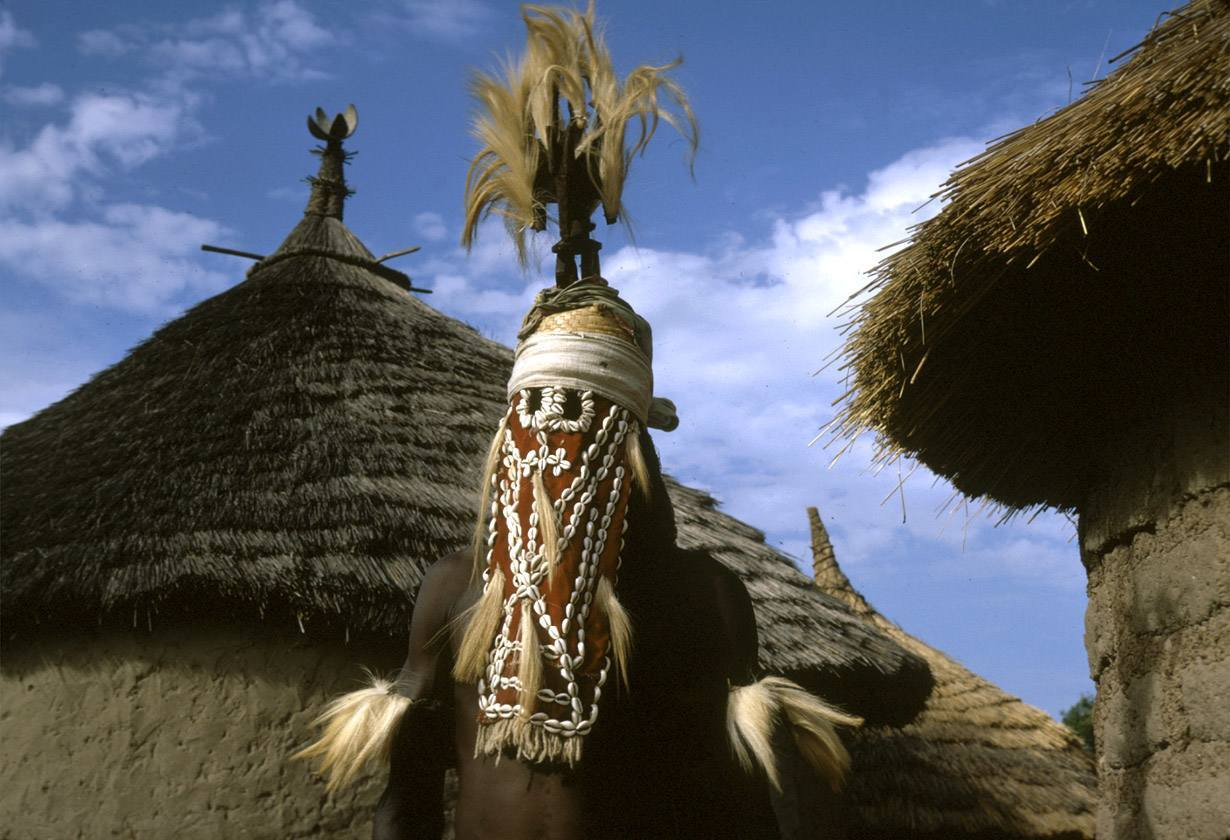 Masked performer wearing vertical Chi wara headdress, Bougouni village, Mali