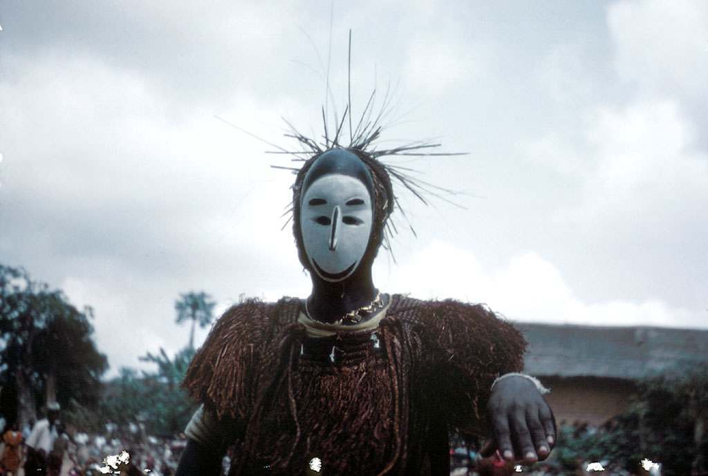 Player wearing the nne mgbo mask at the Okumkpa performance, Mgbom village, Afikpo Village-Group, Nigeria. 1950s
