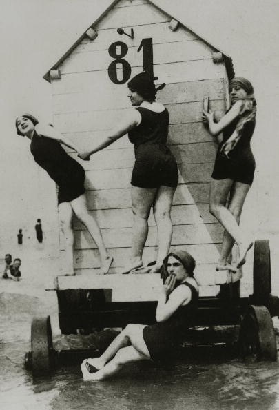 People, Leisure/Holidays, pic: circa 1900's, Four lady bathers dressed in bathing suits of the era, outside a bathing machine at the seaside