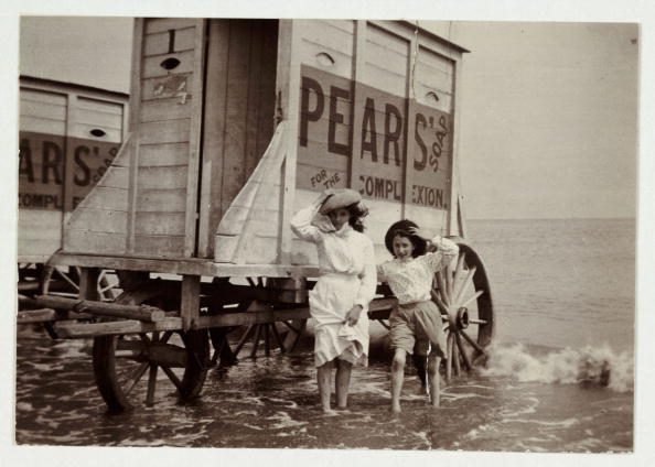 A snapshot photograph of a young woman and a girl at the seaside taken by an unknown photographer in about 1900.