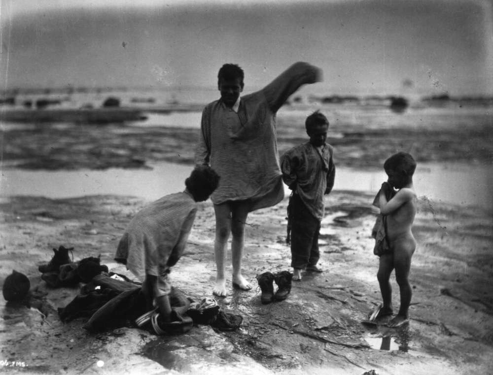 Young boys play on a beach in Whitby, Yorkshire.An albumen print.   (Photo by Frank Meadow Sutcliffe/Getty Images)