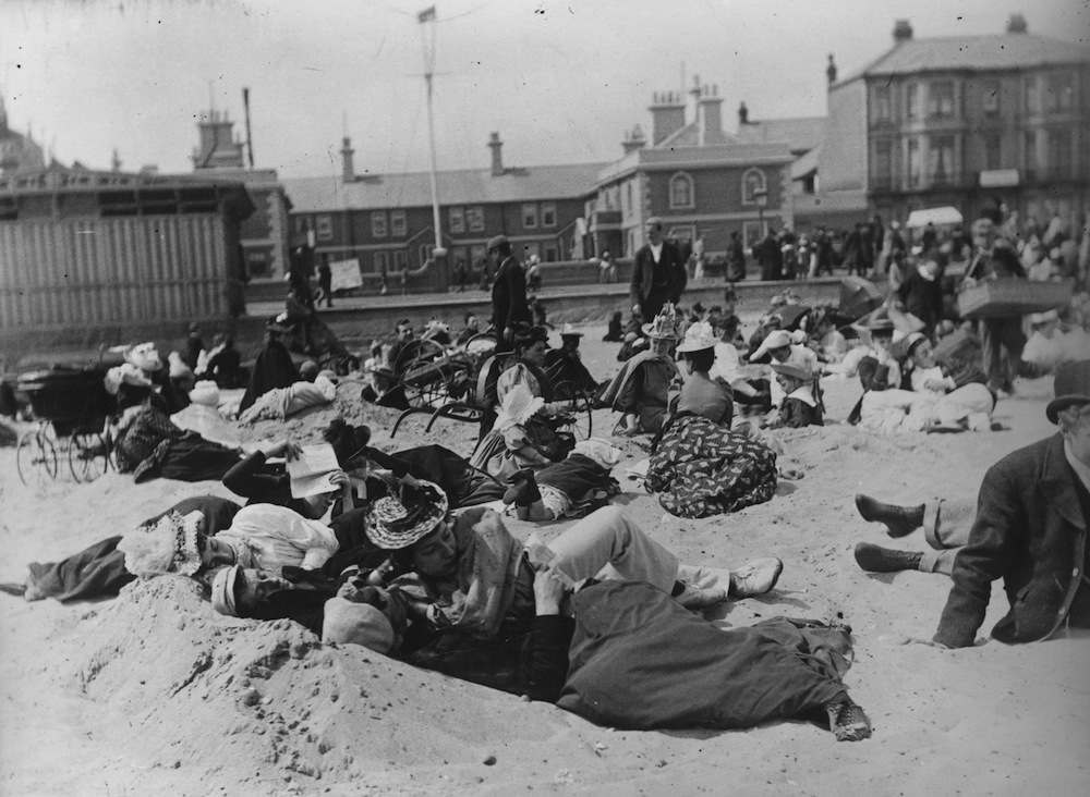 Couples getting to know each other on the beach at Yarmouth.   (Photo by Paul Martin/Getty Images)