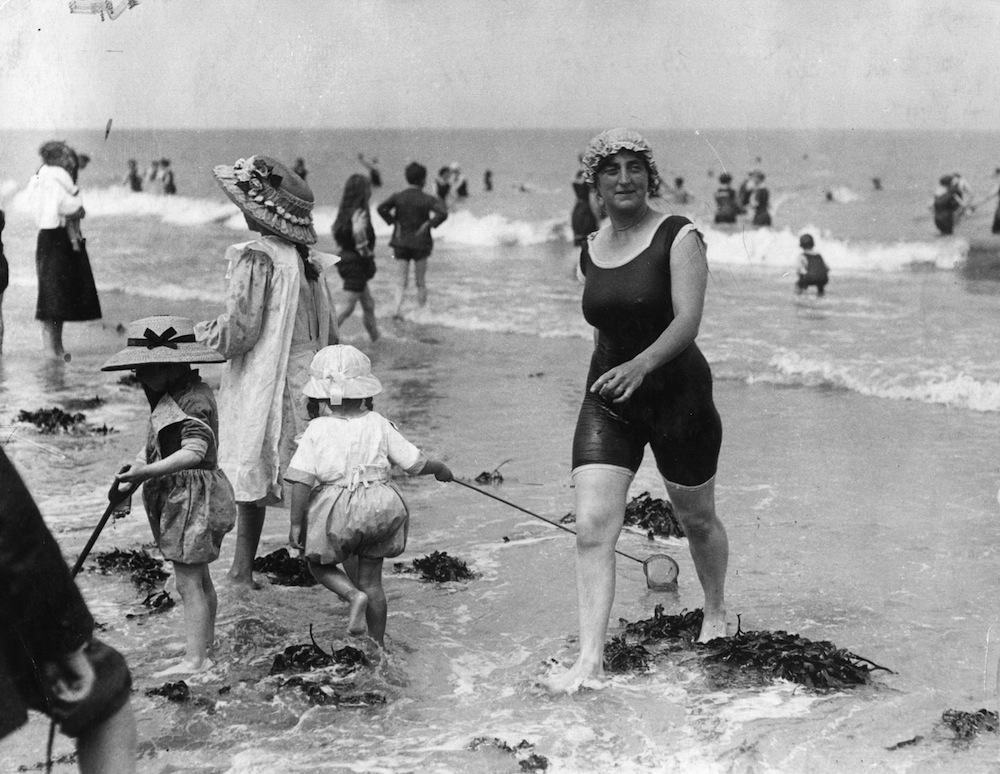 A woman in her bathing costume on the beach at Margate.  (Photo by Central Press/Getty Images)