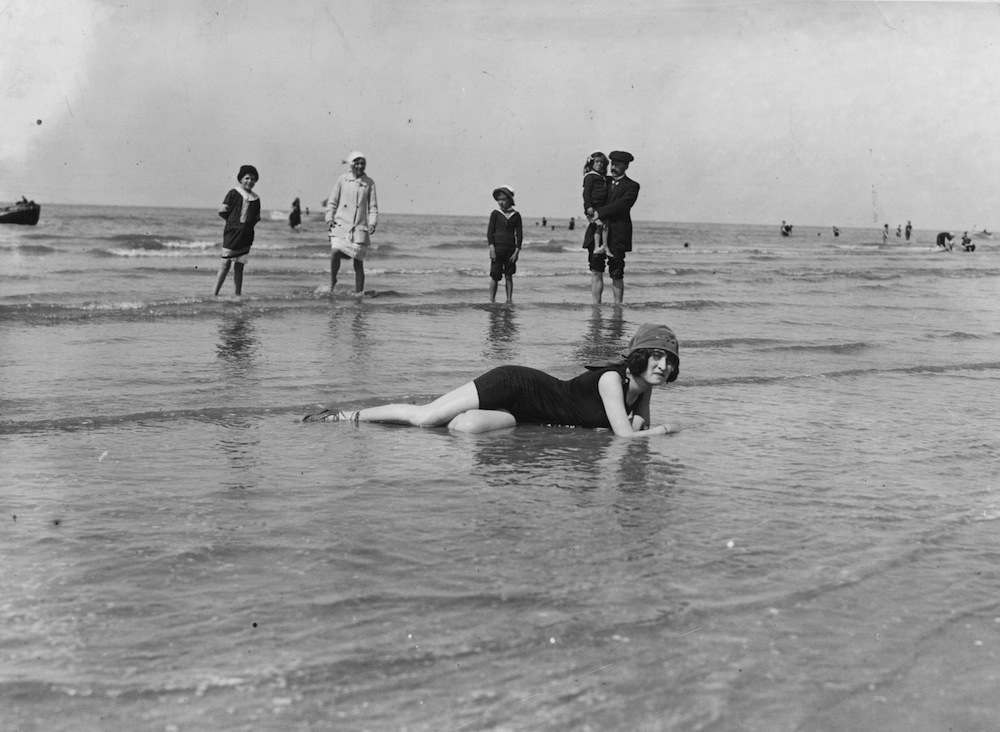 Holiday makers enjoy the beach, France.  (Photo by Topical Press Agency/Getty Images)