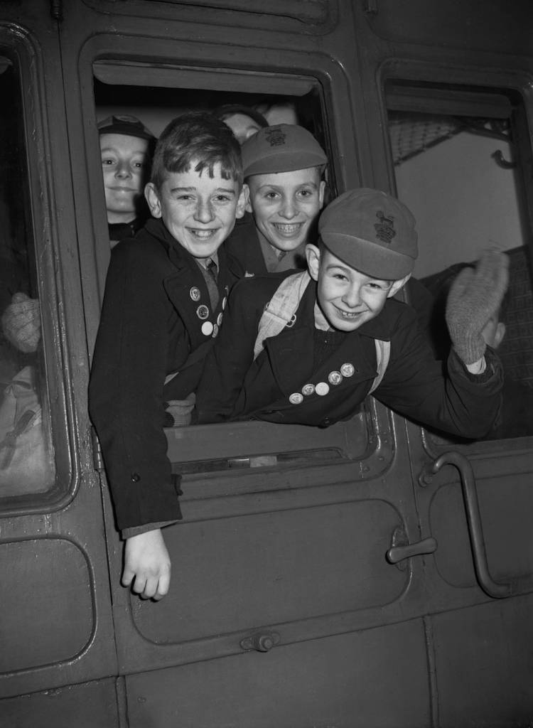 Trainspotters Ian Herbert, Michael Harris and Michael McDonough on board a special train at London Bridge Station, London, 5th January 1953. The 'Spotters' Special' is taking four hundred young rail enthusiasts on a trip to the locomotive works and engine sheds at Stratford in east London. The trip has been organized by the Ian Allen Loco Spotters' Club, which is celebrating its tenth anniversary and the enrolment of its one hundred-thousandth member. (Photo by Ron Burton/Keystone/Hulton Archive/Getty Images)