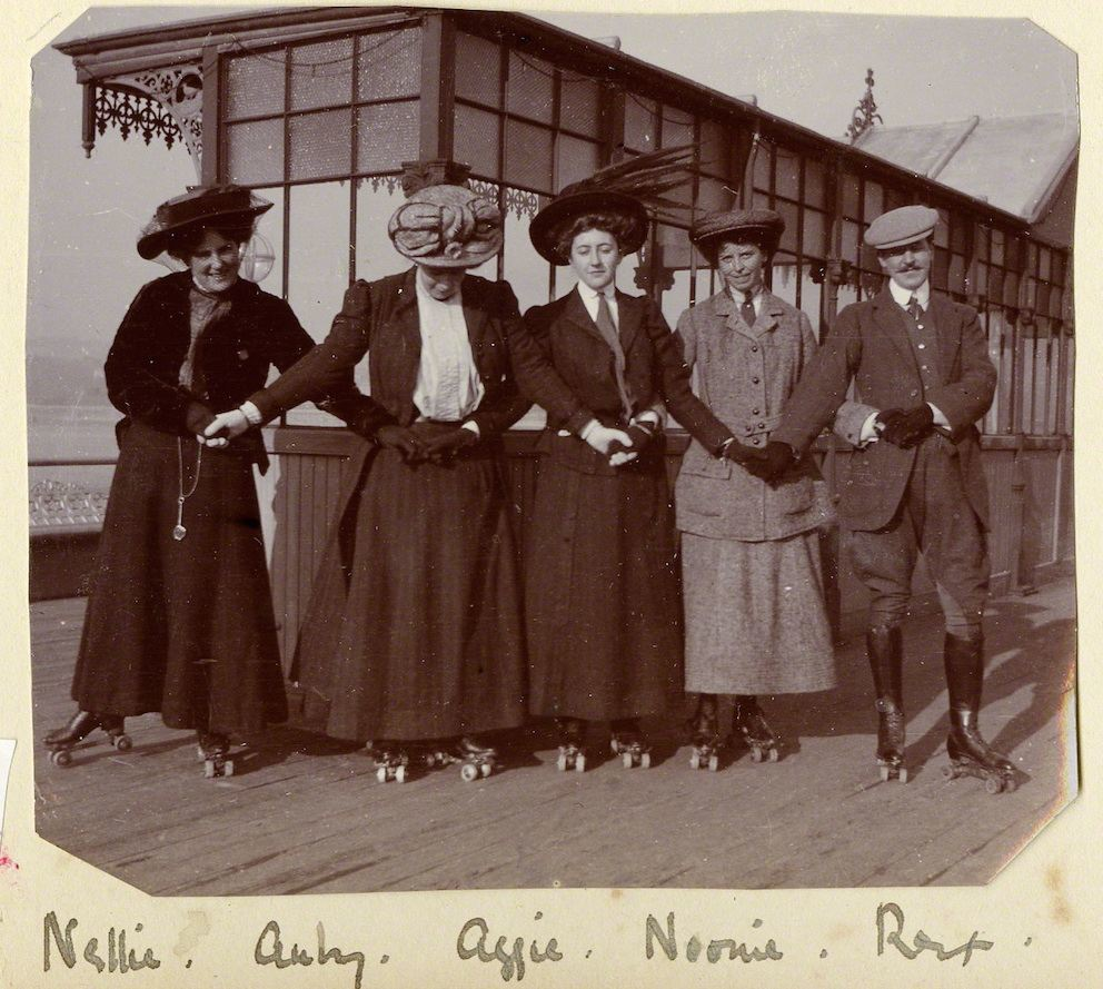 Agatha (in centre) Roller-skating on Torquay pier with the Lucy family. c 1911. 'Roller-skating on the pier was a pastime much in vogue. The surface of the pier was extremely rough and you fell down a good deal, but it was great fun.'