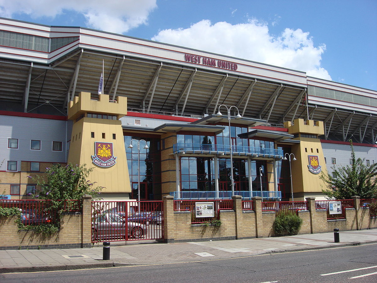Main entrance and 'twin towers' of West Ham United's Dr Marten's stand, Boleyn Ground, Upton Park, London, taken from Green Street.