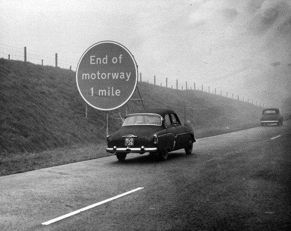 """A view of the Preston Motorway """"End of motorway"""" sign in England. Circa 1950."""