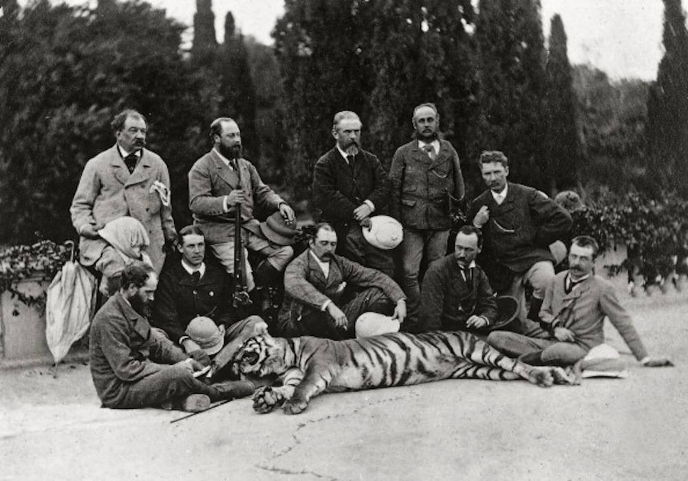 INDIA - CIRCA 1864:  The Prince of Wales photographed with his traveling companions and a tiger, killed during the hunt, in India - Date of Photo: 1864  (Photo by John Murray/Alinari via Getty Images)