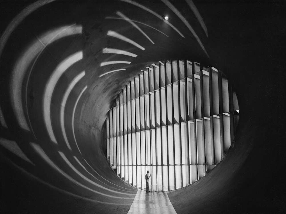 (March 15, 1950) Guide vanes in the 19 foot Pressure Wind Tunnel at Langley Aeronautical Laboratory, National Advisory Committee for Aeronautics, form an ellipse 33 feet high and 47 feet wide. The 23 vanes force the air to turn corners smoothly as it rushes through the giant passages. If vanes were omitted, the air would pile up in dense masses along the outside curves, like water rounding a bend in a fast brook. Turbulent eddies would interfere with the wind tunnel tests, which require a steady flow of fast, smooth air.