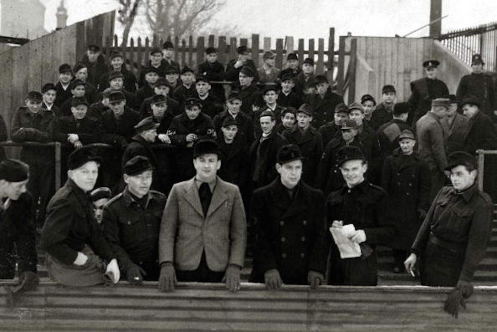 War and Conflict, Post World War Two, pic: circa 1946, London, German prisoners enjoying a day out at Upton Park to watch West Ham United play Bradford, the men allowed out because of their good behaviour  (Photo by Popperfoto/Getty Images)