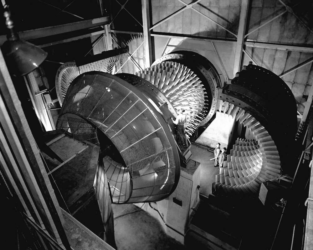 8x6-Foot Supersonic Wind Tunnel  (C-1949-23277): The stator case of the 8 x 6 SWT's seven-row compressor can be opened for inspection and maintenance. Three electric motors totaling 87,000 horsepower turn it. Note the toriod-like screen at the compressor's inlet.