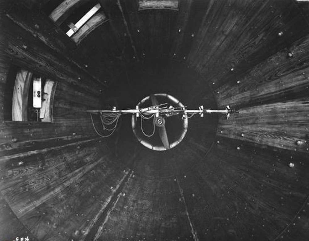 Variable Density Tunnel  (L-405): This interior view of the VDT, taken shortly after it opened in 1922, looks downstream. Note the wooden construction, the propeller in the background and the observation windows. These windows aligned with small portholes in the pressure shell.
