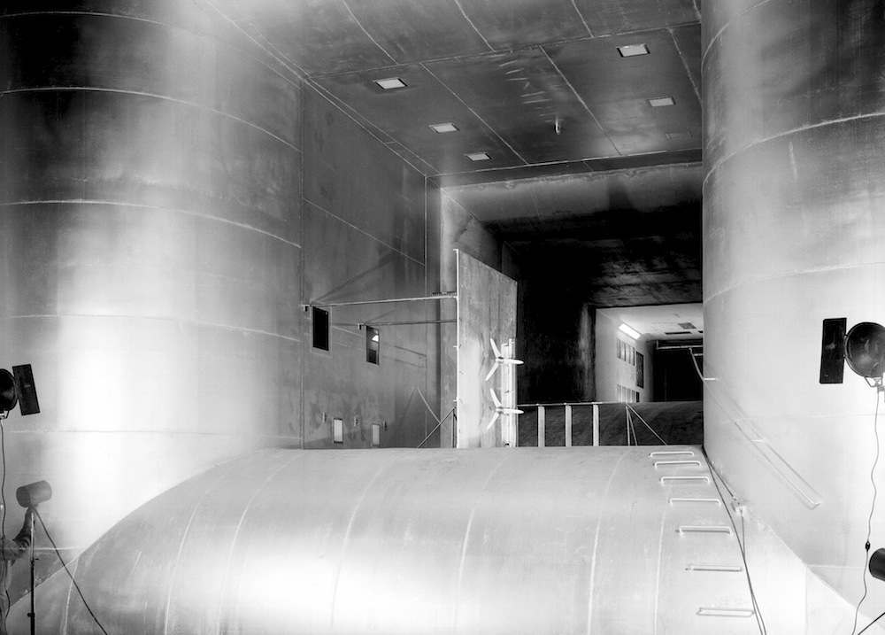 7x10-Foot Low-Speed Wind Tunnel  (1957-L-01191): This unusual view looks through both test sections of the modified 7- 10-Foot LSWT, with the 15.8 x 17-foot test section in the center and the original 7 x 10-foot test section in the distance.