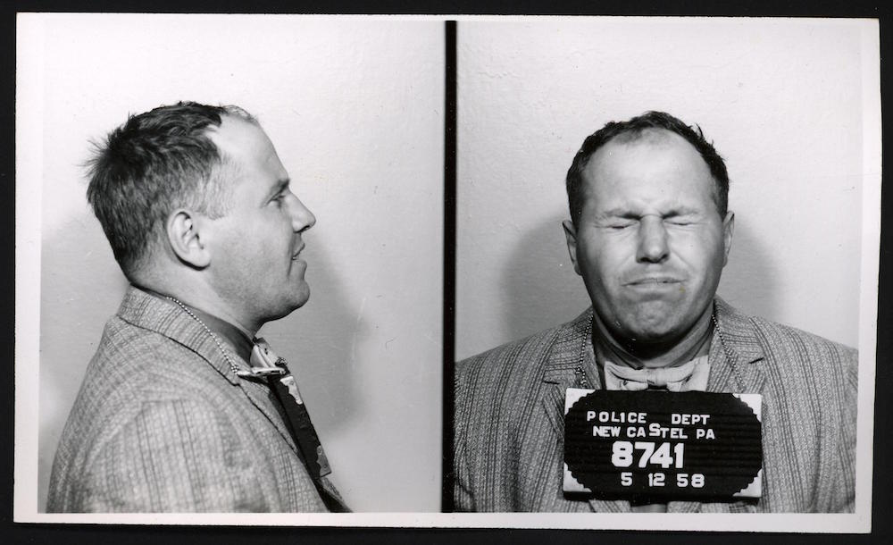 "Charles Esolda was described in court as having the mind of a child. In May, 1955, his only comment to the police after raising a false fire alarm was, ""I don't know why I did it!"" From his mug shot, itappears that he didn't like the camera's flash."
