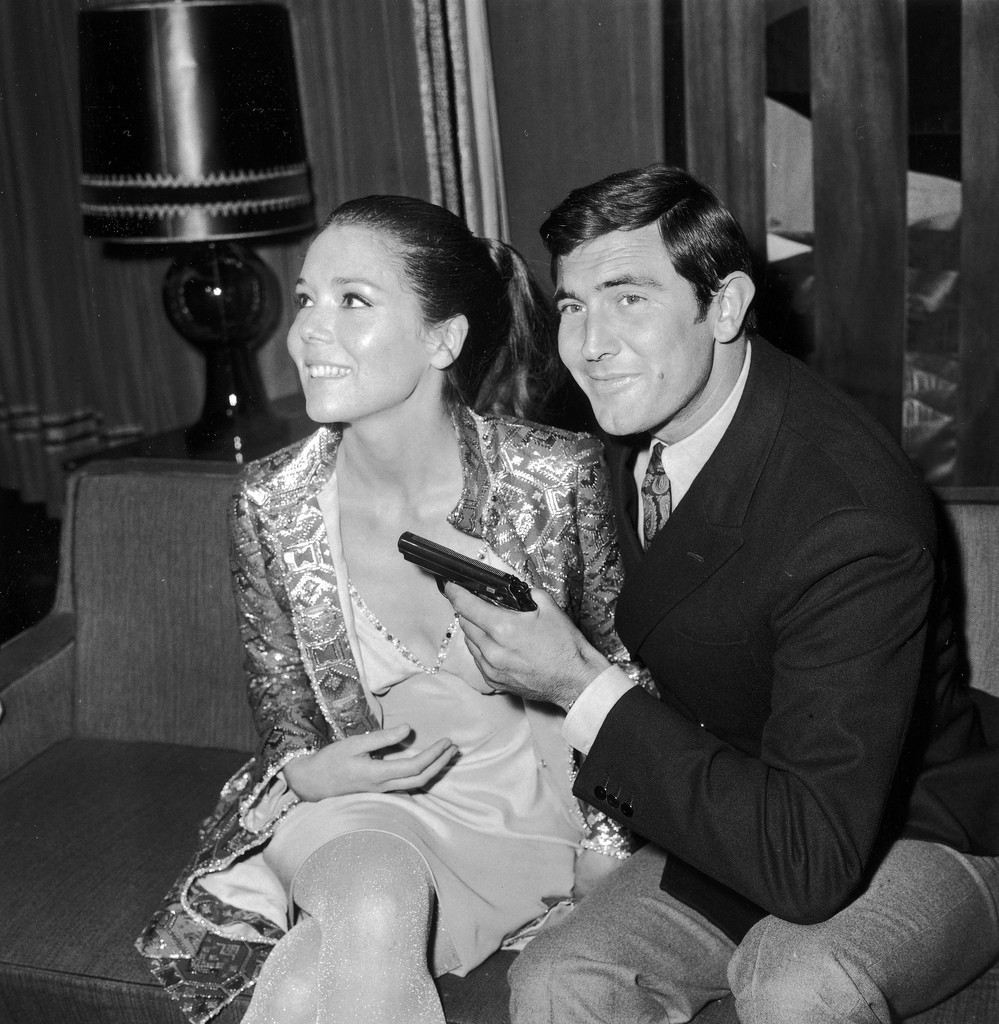 Actor George Lazenby with actress Diana Rigg during a press conference for the James Bond film 'On Her Majesty's Secret Service' in London, 14th October 1968. (Photo by Central Press/Hulton Archive/Getty Images)