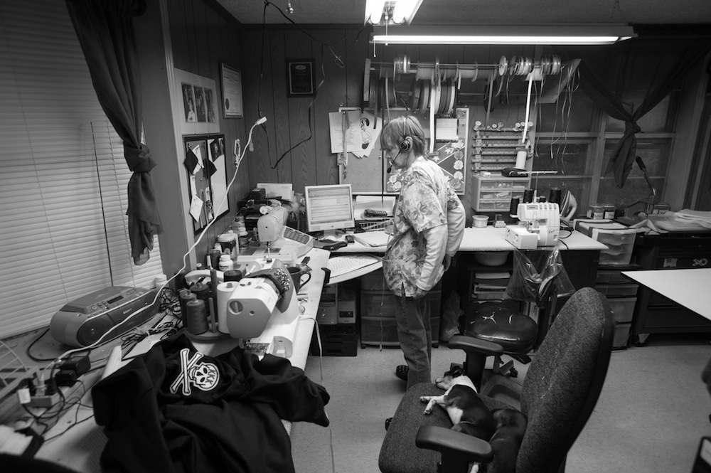 """""""Momma Ruth,"""" a seamstress who makes robes for the Ku Klux Klan in the process of taking an robe order for an Imperial Wizard (an officer within the KKK)."""