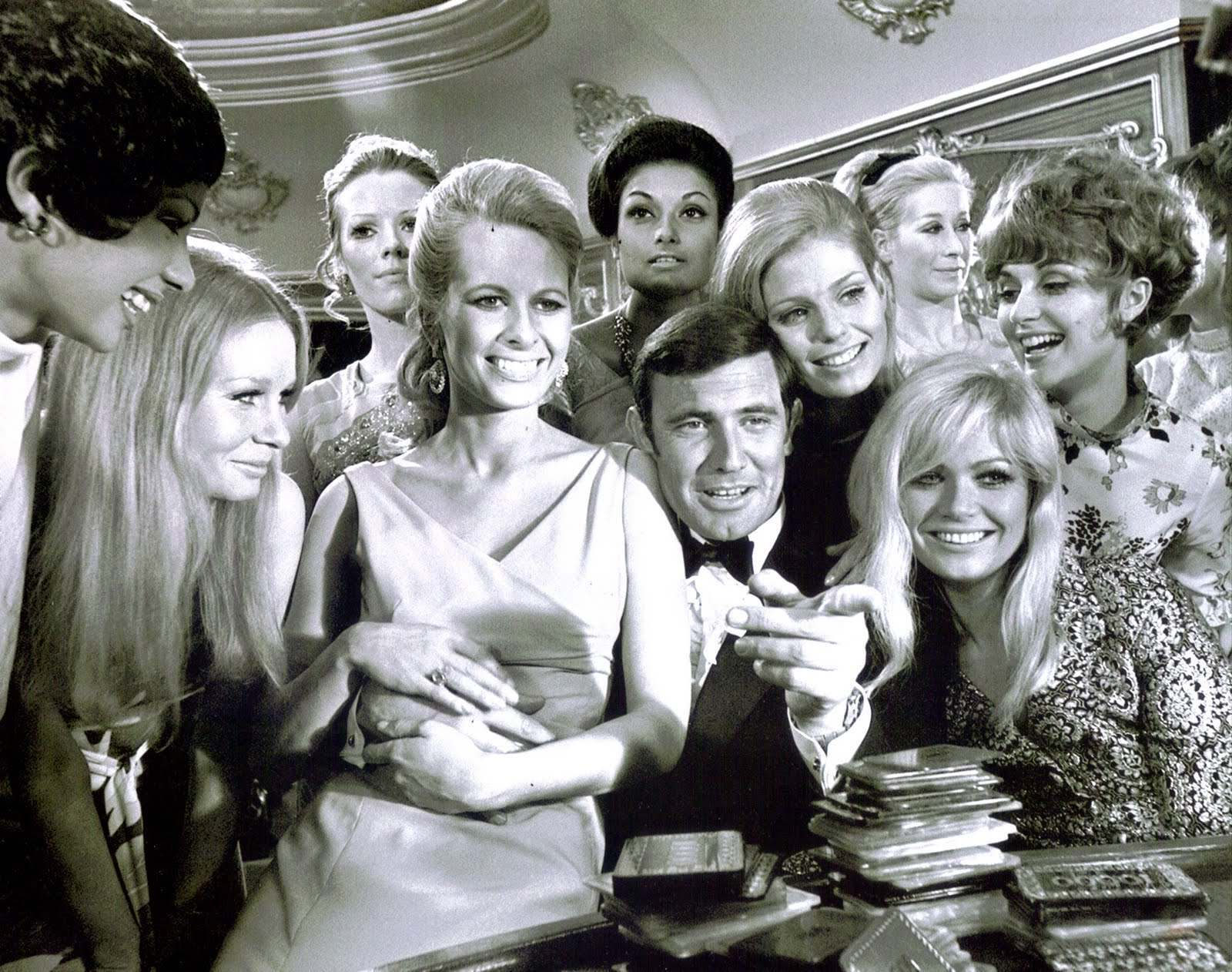 George Lazenby and the 'Bond girls'.