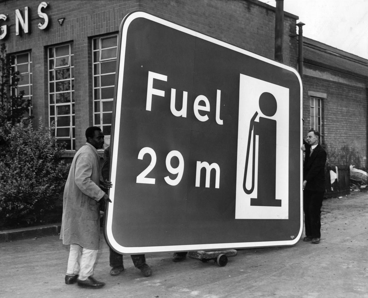 One of the huge signs for the London-Birmingham motorway is wheeled from the Borehamwood factory. The sign reads 'Fuel 29m'. 1959 (Photo by Fox Photos/Getty Images)