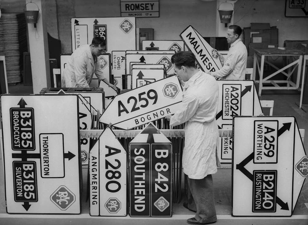 8th April 1936: New roadsigns being stored at the RAC sign factory at Victoria, London. (Photo by Ward/Fox Photos/Getty Images)