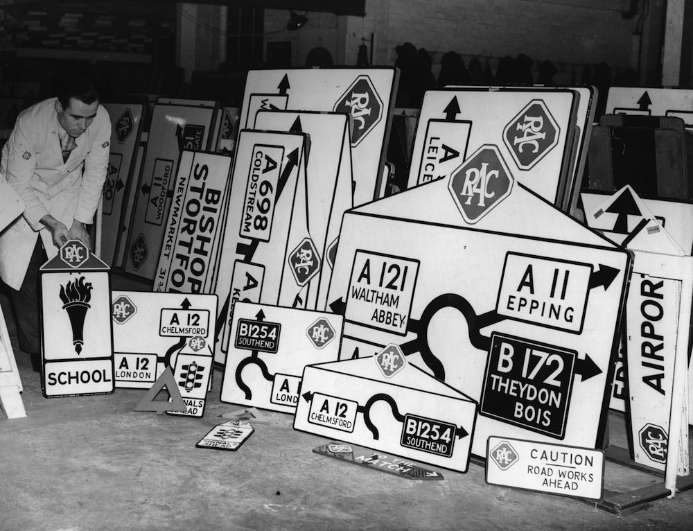 9th February 1938: Half-size road signs for teaching schoolchildren shown with normal size signs. (Photo by Fox Photos/Getty Images)