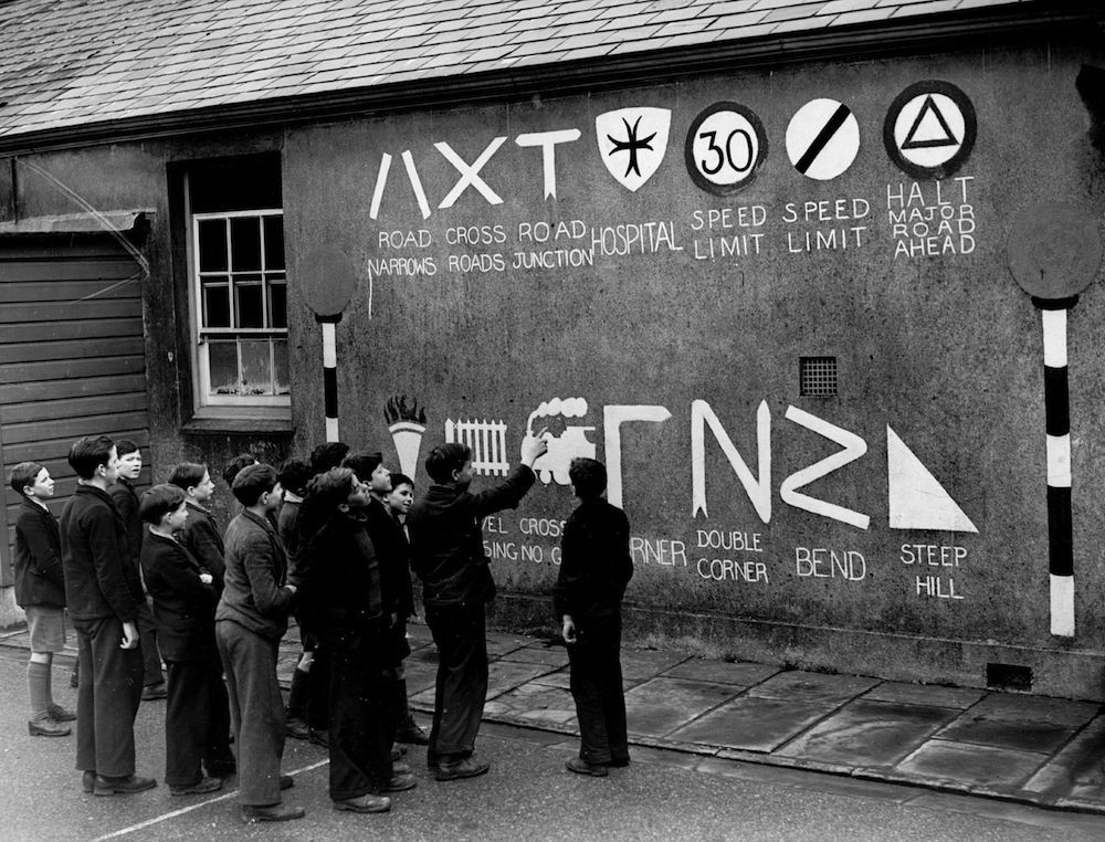 March 1939:  Schoolboys study the plethora of roadsigns on a wall at Cefn Coed School, Merthyr to remind children of  'safety first'.  (Photo by Fox Photos/Getty Images)