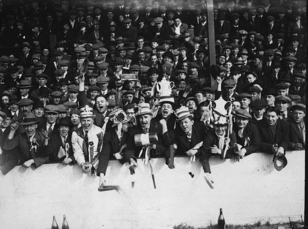 1st March 1930:  The enthusiastic supporters at a London derby match between West Ham United and Arsenal at Upton Park.  (Photo by J. Gaiger/Topical Press Agency/Getty Images)