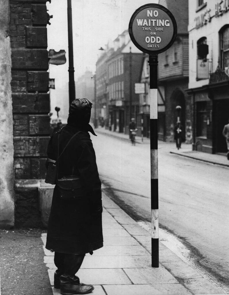 16th December 1935:  New road signs at Rochester indicate to the motorist which side of the street he can park on which date.  (Photo by Hulton Archive/Getty Images)