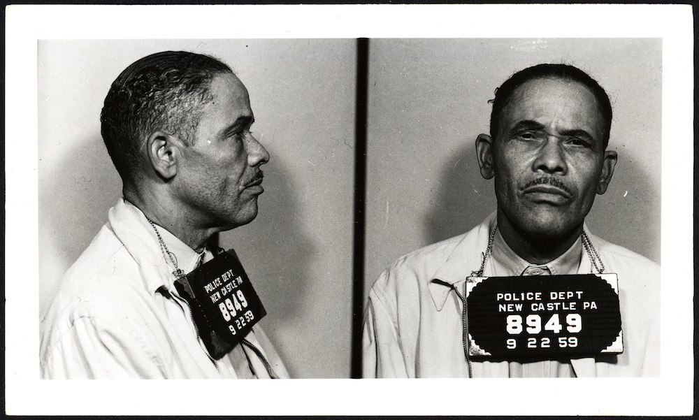"""Oakey Jackson was an infamous underworld figure from Cleveland, known across three states as """"the flim-flam king"""". He was arrested in New Castle in September, 1959, when a police officer observed him attempting to pull the """"pigeon drop"""" confidence trick on an old lady."""