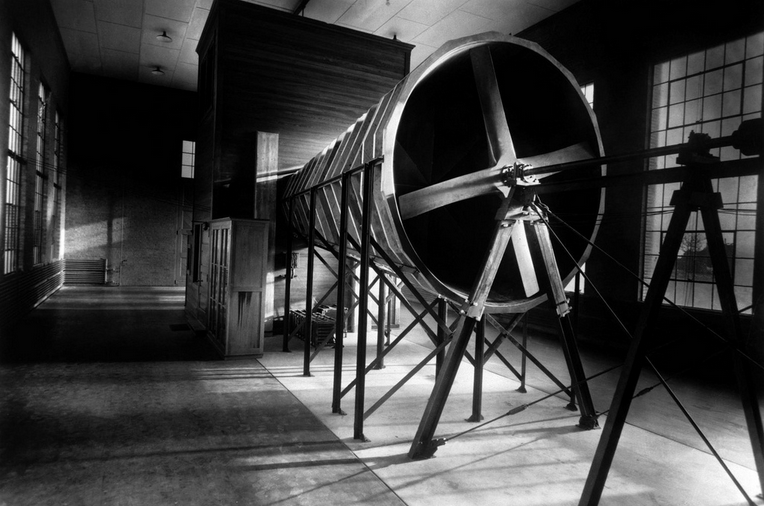 (April 1, 1921) The National Advisory Committee for Aeronautics (NACA)'s first wind tunnel, located at Langley Field in Hampton, VA, was an open-circuit wind tunnel completed in 1920. Essentially a replica of the ten-year-old tunnel at the British National Physical Laboratory, it was a low-speed facility which involved the one-twentieth-scale models. Because tests showed that the models compared poorly with the actual aircraft by a factor of 20, a suggestion was made to construct a sealed airtight chamber in which air could be compressed to the same extent as the model being tested. The new tunnel, the Variable Density Tunnel was the first of its kind and has become a National Historic Landmark.