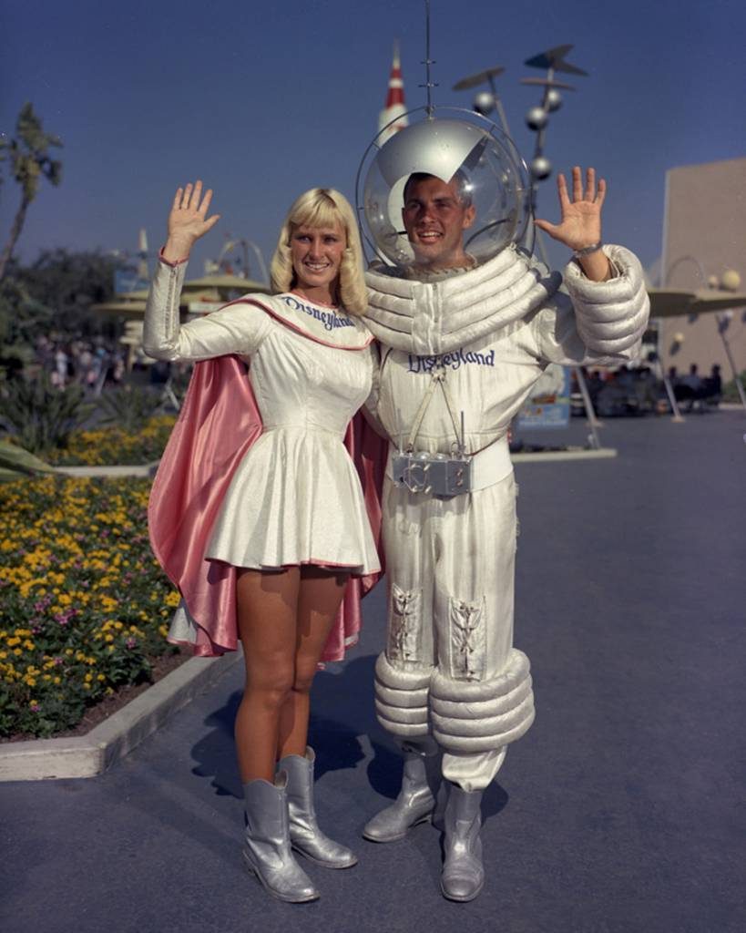 "Guests visiting Tomorrowland in the 1950s and 1960s would encounter a unique original Disneyland character that symbolized Americans' interest in space exploration. In this rare photo from the summer of 1960, the Tomorrowland ""Spaceman"" is apparently joined by ""Spacewoman."" Via"