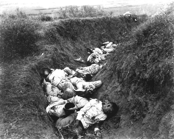 View of the insurgent Filipino dead as they fell in their trenches during fighting in the Philippine-Ameirican War, near Santa Ana, February 1899.