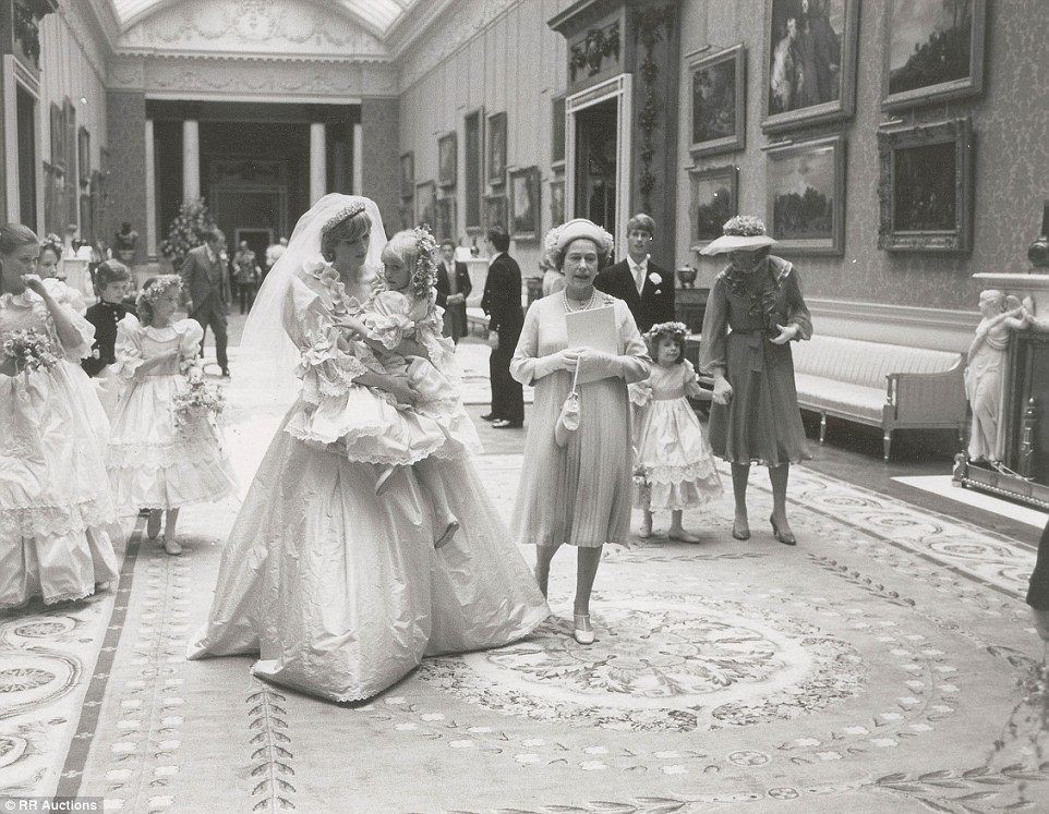 Princess Diana holding 5-year-old Clementine Hambro, her youngest bridesmaid