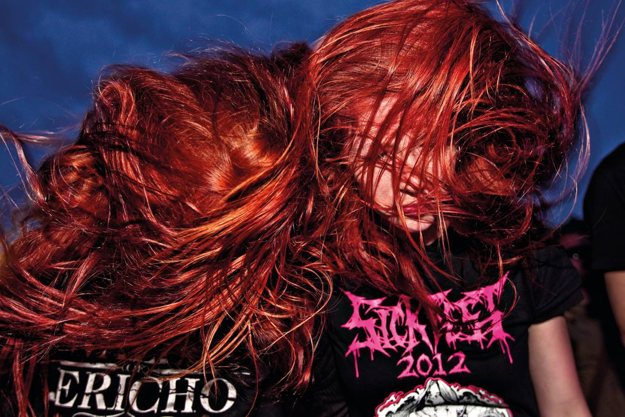 """Karina and Stine are headbanging during a """"Lamb of God """" concert at COPENHELL, Denmark's largest metal rock festival."""