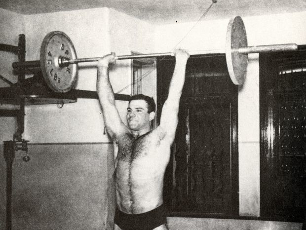 """Lifting weights as a novice at the Maccabi club in London, 1956.""    (On The Move: A Life/Knopf)"