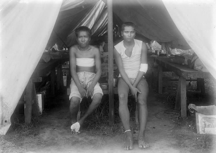 Two wounded insurgents in tent hospital on First Reserve Grounds. Manila, 1899