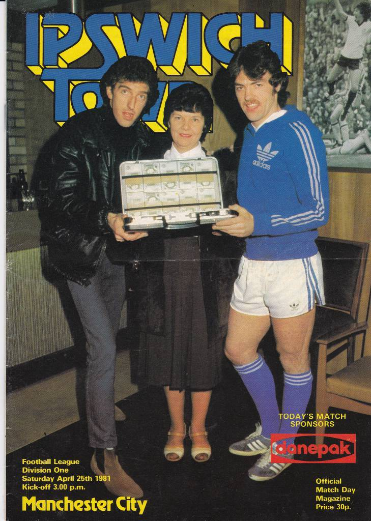 Ipswich Town vs Manchester City - 1981 - Cover Page  John Wark, a wee woman, and special guest BA Robertson welcome Citeh to Portman Road in 1981