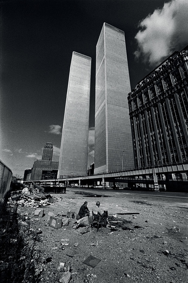 Two homeless men squat in the shadow of the recently completed World Trade Centre, New York, 1975. Photograph: J-P Laffont