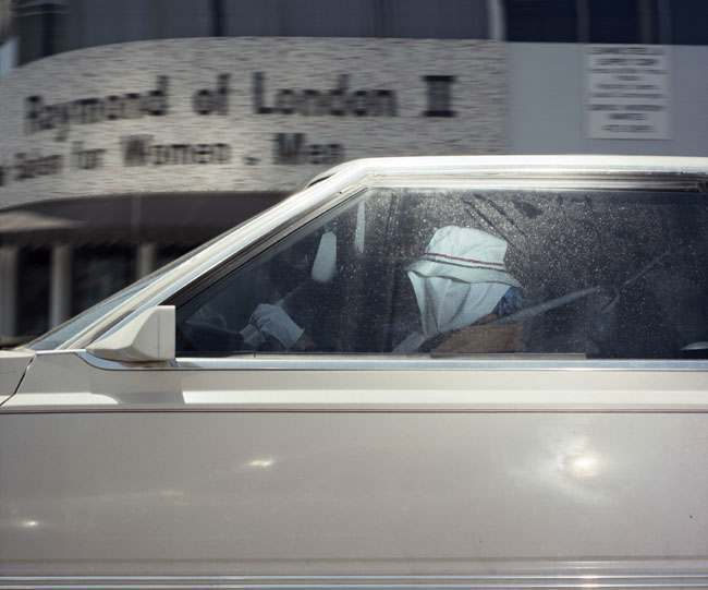 Woman pausing at a Beverly Hills intersection at 2:22 p.m. on September 12, 1990