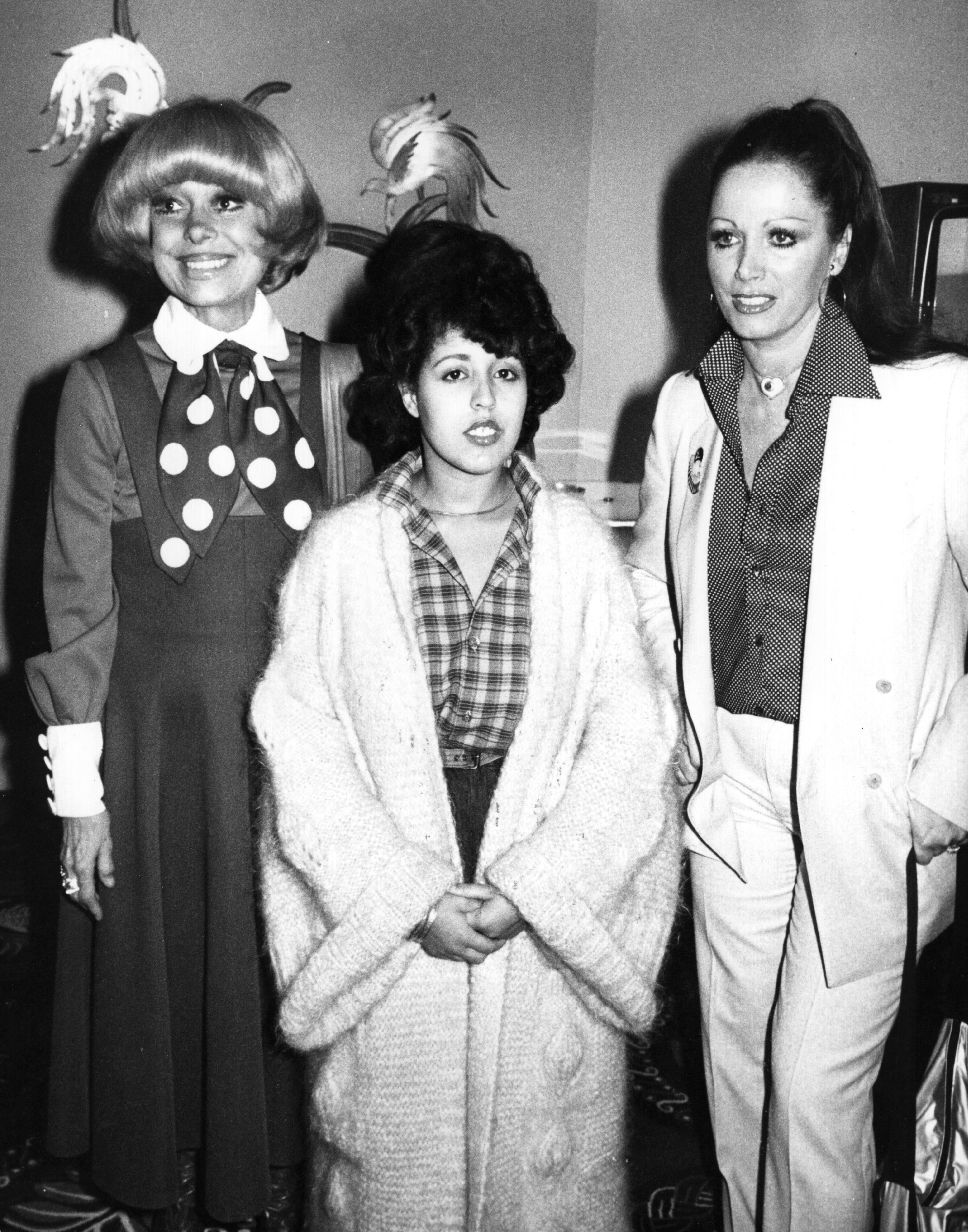 29th October 1979:  Carol Channing, actress and star of the musical 'Hello Dolly', Polly Styrene, singer and songwriter formerly of punk band X Ray Spex, and novelist Jackie Collins, from left to right, at the Savoy Hotel for the 'Women Of The Year' luncheon. The event was held in aid of the Greater London Fund For The Blind charity.  (Photo by Wesley/Keystone/Getty Images)